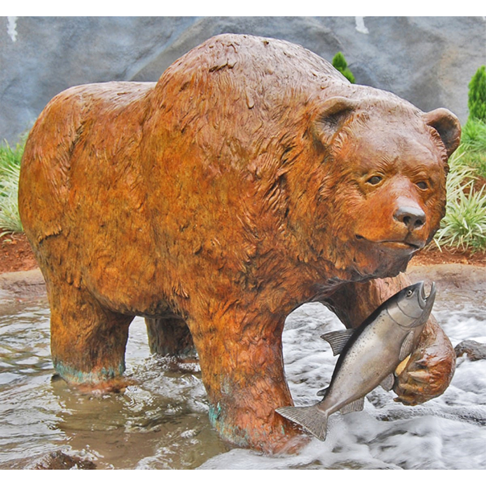 Bronze statue of a bear catching fish