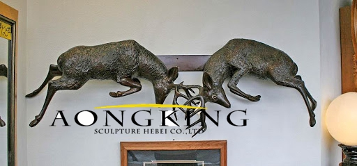 Sculpture of elk on the wall