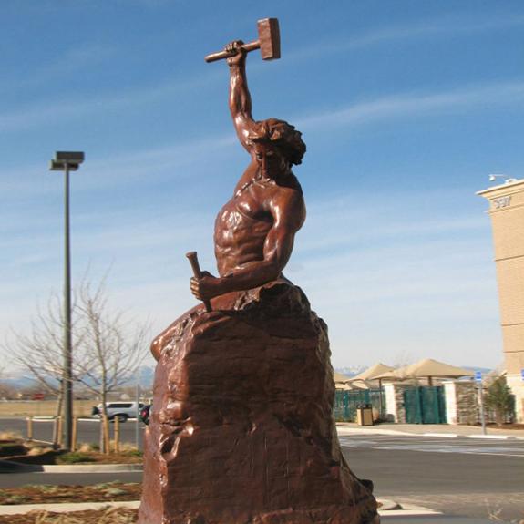 Cast bronze man statue
