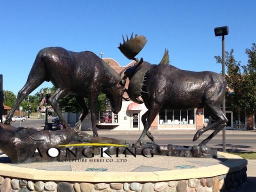 Fighting elk copper sculpture