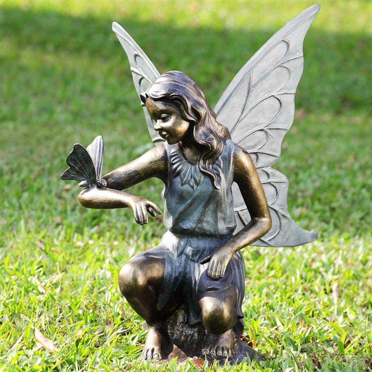 Girl angel sculpture with butterfly