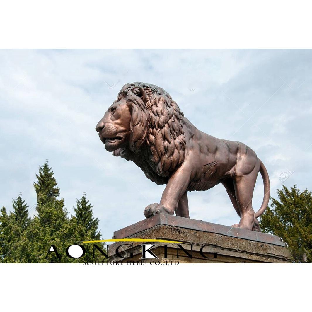 Standing ferocious lion statue with pedestal