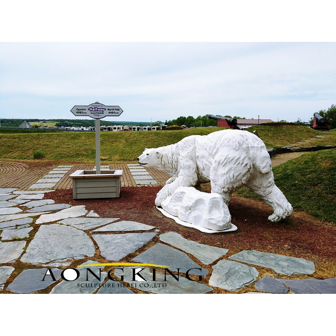 White fiberglass polar bear statue