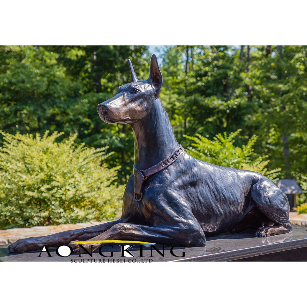 Lying in the ground dog bronze statue