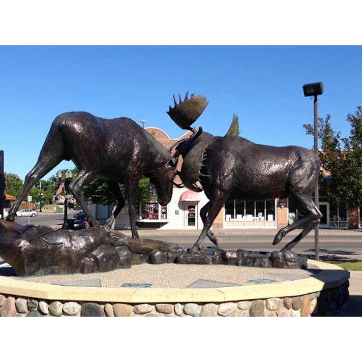 Sculpture of a moose in battle