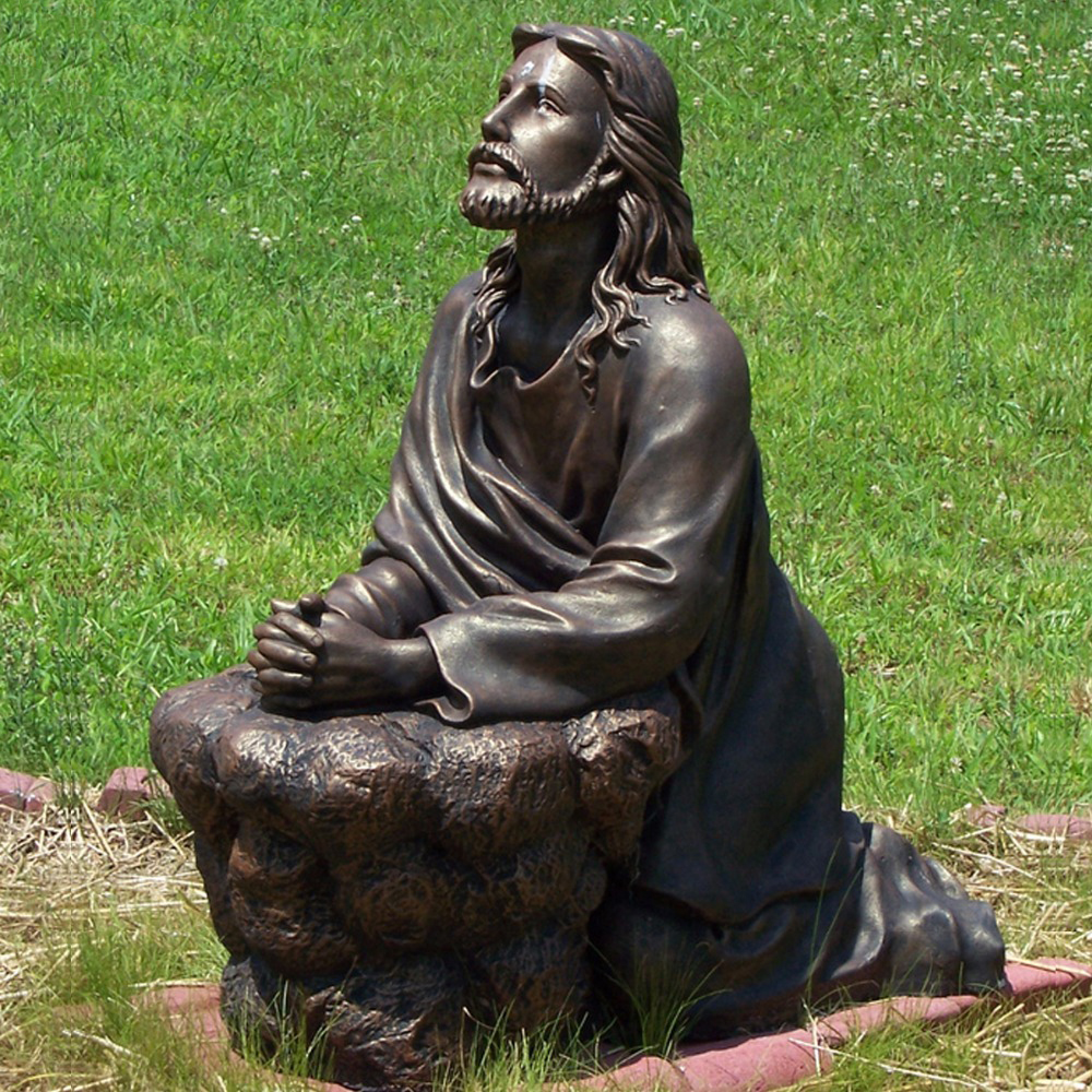 Kneeling praying bronze jesus