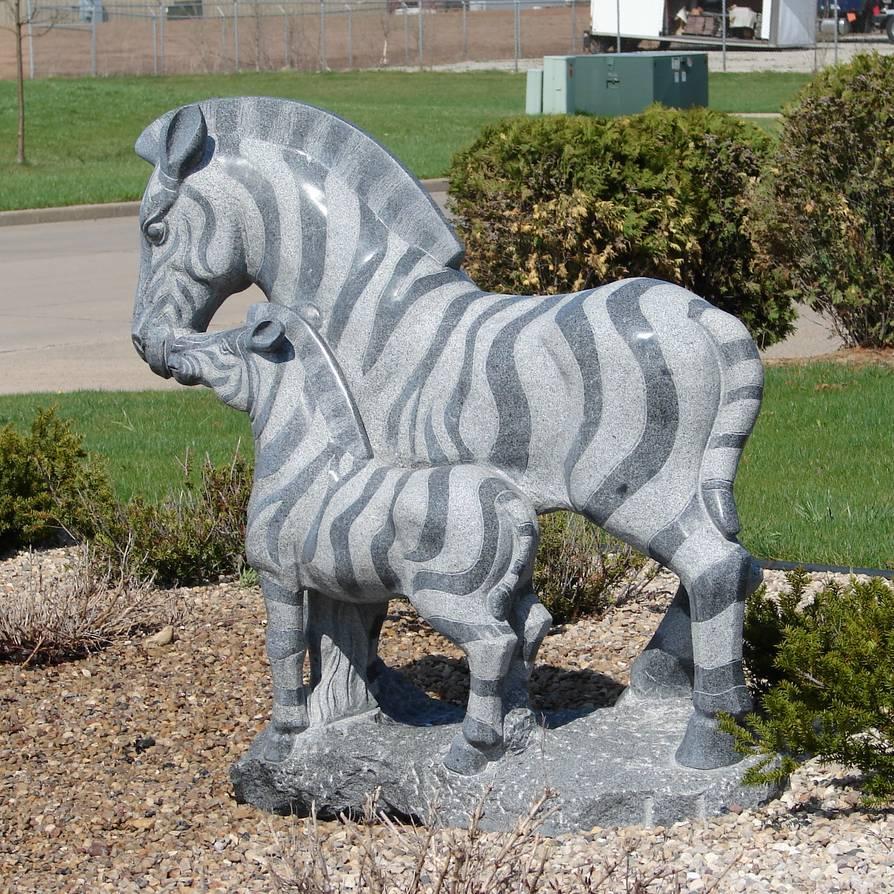 Stone zebra statue with baby