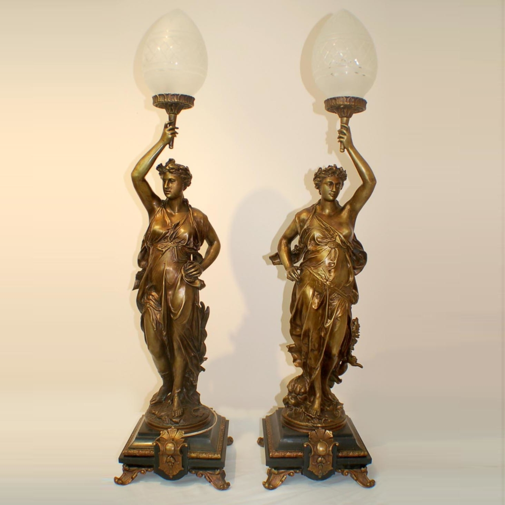 A pair of figure lamps