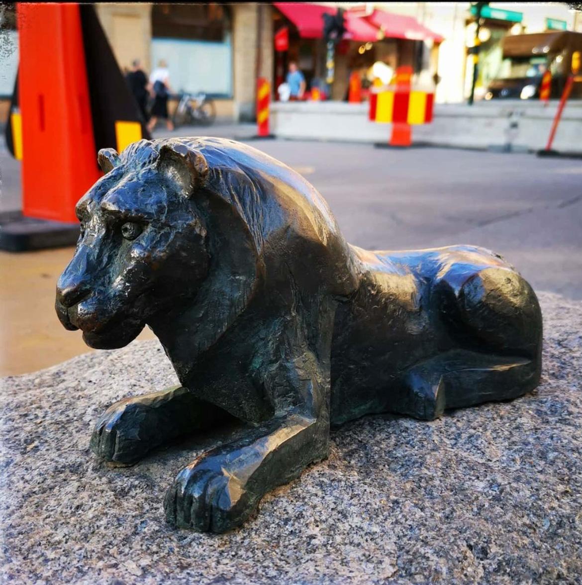 A bronze little lion sculpture