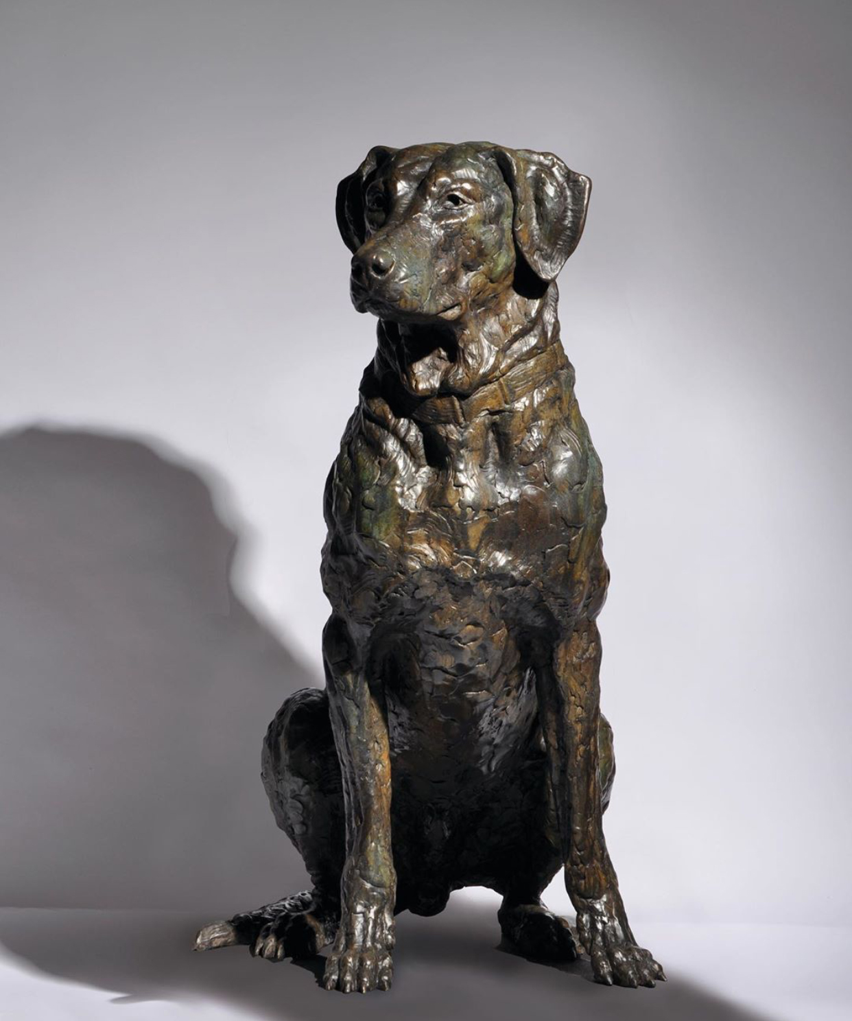 Bronze dog sculpture for garden