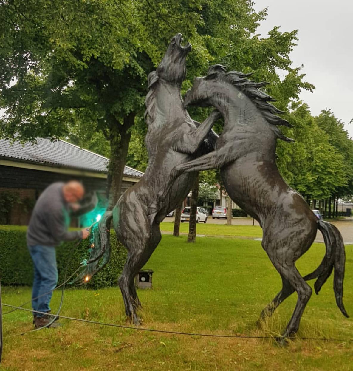 Two bronze fighting horse sculpture
