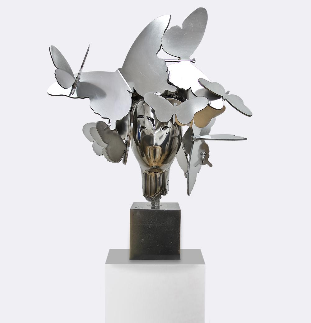 Attract Manolo Valdez copper sculpture